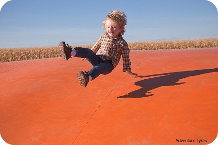 Toddler bouncing at pumpkin patch AT