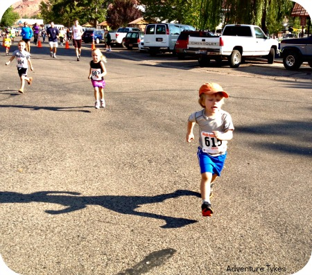 toddler running first race.
