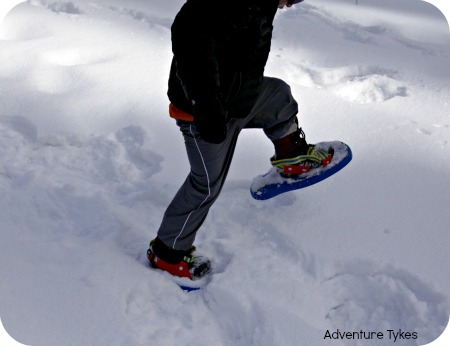 Toddler snowshoeing in Tubbs snowshoes