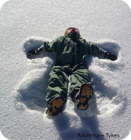 Toddler making a snowangel