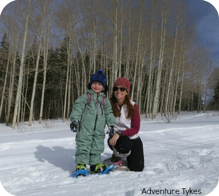 Mom and tyke snowshoeing