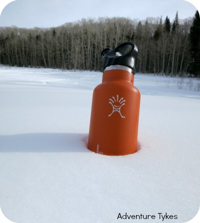 Hydro Flask water bottle in snow