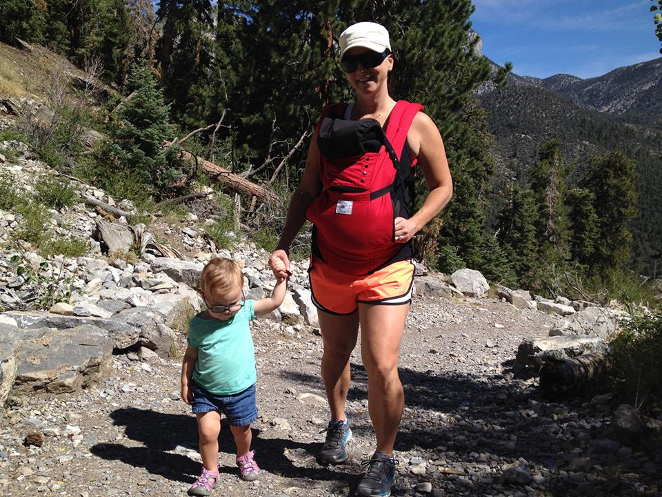Mom hiking with toddler and infant